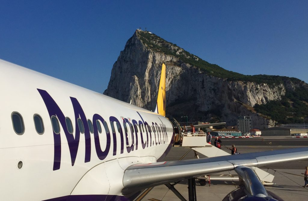 Picture of a plane in front of the Gibraltar rock